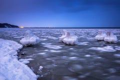 Frozen coastline of Baltic Sea in Gdynia. At dusk, Poland Stock Photos