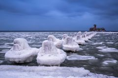 Frozen coastline of Baltic Sea in Gdynia. At dusk, Poland Stock Photography