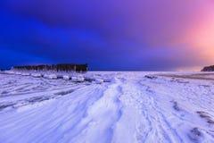 Frozen coastline of Baltic Sea in Gdynia at night. Frozen coastline of Baltic Sea in Gdynia at dusk, Poland Stock Image