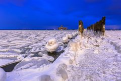 Frozen coastline of Baltic Sea in Gdynia at night. Poland Stock Photography