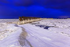 Frozen coastline of Baltic Sea in Gdynia at night. Poland Royalty Free Stock Photos