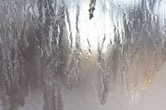 Texture of frozen glass. Light background stock image