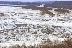 Frozen Confluence of Two Midwest Rivers in Winter. Frozen Confluence of the Wisconsin and Mississippi Rivers in Winter at Pikes Peak State Park in Iowa stock image