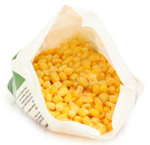 Frozen Corn in Open Bag. Open bag of uncooked frozen corn niblets over white with clipping path Royalty Free Stock Photography