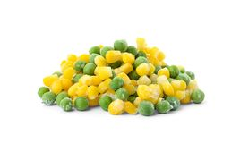 Frozen corn and peas on white background. Vegetable preservation stock photos
