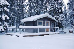 Frozen cottage. Small cottage covered in snow Stock Photography
