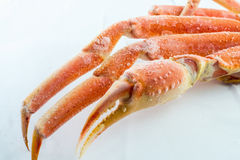 Frozen crab claws. Frozen king crab legs for sale in the store Royalty Free Stock Photos