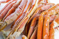 Frozen crab claws. Frozen king crab legs for sale in the store Stock Photography