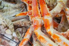 Frozen crab legs and other seafood in supermarket royalty free stock images