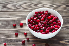 Frozen cranberries on the wooden table Royalty Free Stock Photos