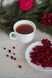 Frozen cranberry, cup of tea on wooden background Royalty Free Stock Photos