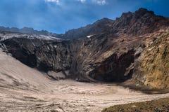 Frozen crater lake inside Mutnovsky Volcano. Kamchatka, Russia stock photo