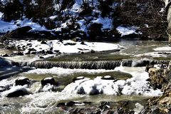 Frozen Creek In The Forest. A photo of a frozen creek with stones, rocks. Somewhere in Romania Stock Image