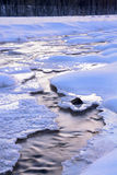 Frozen creen winds through snow Royalty Free Stock Photos