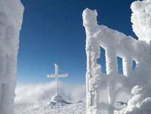 Frozen cross in the mountain Stock Images