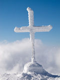 Frozen cross in the mountain Stock Photography