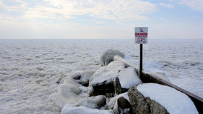 Frozen Danger of Diving. A sign is rendered obvious when the winter cover a popular swimming area Stock Image