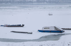 Frozen Danube on ice, small fishing boats. Frozen river Danube on ice at -15C, with small fishing boats river scape Stock Photos
