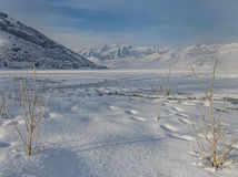 Frozen Deer Creek Reservoir in Utah. Deer Creek Reservoir with Mt. Timpanogos in the background Stock Images
