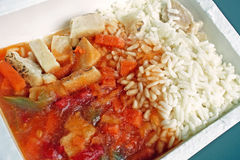 Frozen Dinner. Microwaveable frozen dinner of rice, sauce, chicken pieces and vegetables Royalty Free Stock Photography