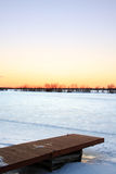 Frozen Dock. A dock sits frozen in time during a winter on Lake Ontario Stock Photography