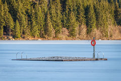 Frozen Dock. A frozen dock in the middle of Alta Lake, Whistler Royalty Free Stock Photo