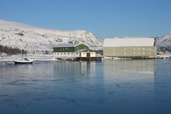 Frozen docks. Docks of the Busknes fjord frozen in wintertime royalty free stock photo