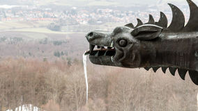Frozen Dragon. Dramatic Picture of a Frozen Medieval Dragon Statue with an Icicle on the Giechburg Castle Ruin in winter Bavaria, Germany Stock Photography