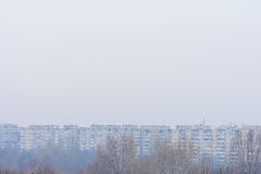 Frozen dry trees in winter and city panoramic view. Winter pictu Stock Image