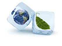 Frozen Earth. Earth globe and green leaf frost in ice cube. Glaciation concept Royalty Free Stock Images