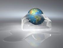 Frozen Earth. Conceptual Earth globe frozen in an ice cube - 3d render Stock Image