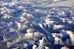 Frozen earth of North of America from airplane in sky Stock Images