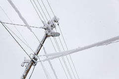 Frozen Electric Power Pole Stock Image