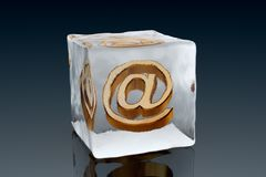 Frozen email. A golden AT symbol frozen inside an ice cube (3D rendering Stock Photography