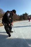 Frozen Europe. The city police measure ice thickness in heavy frost on one third of the ponds 3rd February 2012 in Brno-Lisen, Czech Republic Stock Photos
