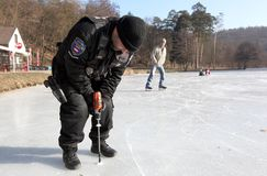 Frozen Europe. The city police measure ice thickness in heavy frost on one third of the ponds 3rd February 2012 in Brno-Lisen, Czech Republic Royalty Free Stock Images