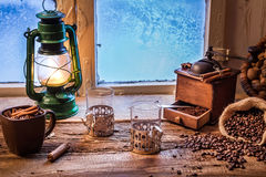 Frozen evening with hot coffee Royalty Free Stock Photography