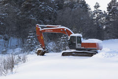 Frozen excavator near the forest road Stock Image