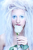 Frozen fairy. Close-up portrait of beautiful blonde frozen fairy nymph girl with white rose Stock Photo