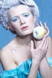 Frozen fairy with apple Stock Images