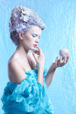 Frozen fairy with apple Stock Image