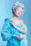 Frozen fairy with apple Stock Photography