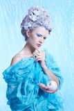 Frozen fairy with apple Stock Photos