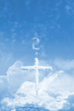 Frozen faith election. Frozen cross over the clouds, in the sky, standing on a stone, with a question mark, made of clouds. It can stand for praying, or faith Stock Image