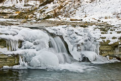 The frozen falls. The falls on a mountain stream have frozen in the winter Royalty Free Stock Image