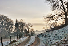Frozen Farm Track At Sunrise Royalty Free Stock Photos
