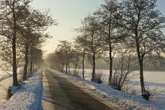 Frozen farmland. A sunny winter day in Dutch landscape Stock Photos