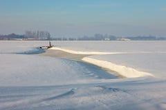 Frozen farmland. A sunny winter day in Dutch landscape Stock Photo