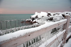 Frozen fence covered in icicles overlooking Lake Michigan in winter Royalty Free Stock Photography