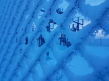 Frozen fence in winter wonderland Norway. Power station behind the fence. Early morning. Blue hour stock photos